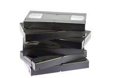 Föråldrade VHS videokassetter på vit bakgrund Fotografering för Bildbyråer