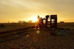 Förödelse på solnedgången Arkivfoto