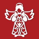 För ängelwhith för vit jul hjärta i hans händer på den röda bakgrunden Konturn av ängeln kan använda för kortet, laser klippa plo Royaltyfria Foton