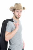För affärsman eller bärande cowboyhatt för ung man och svart omslag Arkivfoto