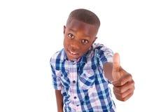 För afrikansk amerikanpojkedanande för tummar svarta människor upp - Fotografering för Bildbyråer