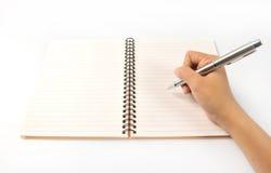för anteckningsbokblyertspenna för bakgrund hand isolerad white hand pennan Arkivbild