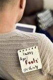 För april för ung man och för text lycklig dag dumbommar Arkivfoton