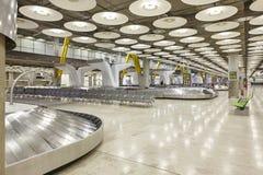 För bagagebälte för internationell flygplats område för reklamation inget Lopplodisar royaltyfri bild