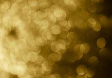 för bakgrundsbokeh för guld abstrakta cirklar för julbakgrund Arkivfoto