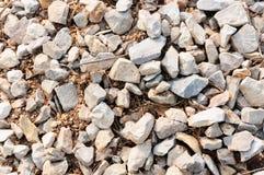 För bakgrundsdag för många stenar textur Arkivbilder