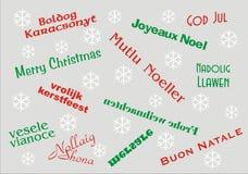 För banermultipel för glad jul språk Fotografering för Bildbyråer