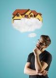 för begreppsdollaren för 100 bills det gjorda huset intecknar ut Arkivfoton