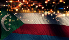 För Bokeh för natt för Comoros nationsflaggaljus bakgrund abstrakt begrepp Arkivfoton