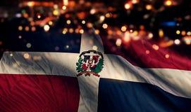För Bokeh för natt för Dominikanska republikennationsflaggaljus bakgrund abstrakt begrepp Royaltyfri Foto