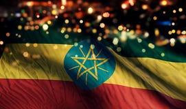 För Bokeh för natt för Etiopien nationsflaggaljus bakgrund abstrakt begrepp Arkivbild