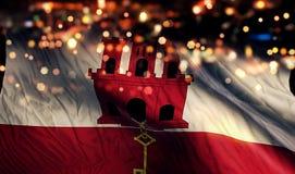 För Bokeh för natt för Gibraltar nationsflaggaljus bakgrund abstrakt begrepp Royaltyfria Bilder