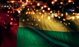 För Bokeh för natt för Guinea Bissau nationsflaggaljus bakgrund abstrakt begrepp Royaltyfria Foton