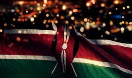 För Bokeh för natt för Kenya nationsflaggaljus bakgrund abstrakt begrepp Arkivfoton