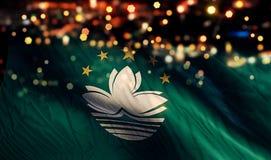 För Bokeh för natt för Macao nationsflaggaljus bakgrund abstrakt begrepp Arkivbild