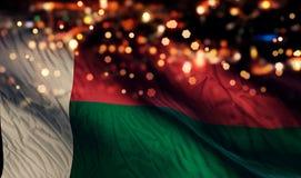 För Bokeh för natt för Madagascar nationsflaggaljus bakgrund abstrakt begrepp Arkivfoton