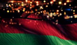 För Bokeh för natt för Malawi nationsflaggaljus bakgrund abstrakt begrepp Royaltyfria Bilder