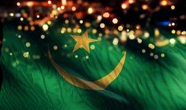 För Bokeh för natt för Mauretanien nationsflaggaljus bakgrund abstrakt begrepp Fotografering för Bildbyråer