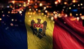 För Bokeh för natt för Moldavien nationsflaggaljus bakgrund abstrakt begrepp Royaltyfri Bild