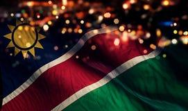 För Bokeh för natt för Namibia nationsflaggaljus bakgrund abstrakt begrepp Royaltyfri Foto