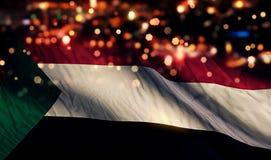 För Bokeh för natt för Sudan nationsflaggaljus bakgrund abstrakt begrepp Arkivbild