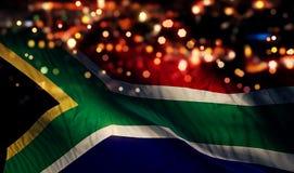 För Bokeh för natt för Sydafrika nationsflaggaljus bakgrund abstrakt begrepp royaltyfri foto