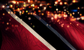 För Bokeh för natt för Trinidad och Tobago nationsflaggaljus bakgrund abstrakt begrepp Royaltyfri Bild