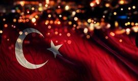För Bokeh för natt för Turkiet nationsflaggaljus bakgrund abstrakt begrepp Arkivbild