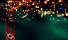 För Bokeh för natt för Turkmenistan nationsflaggaljus bakgrund abstrakt begrepp Royaltyfri Bild
