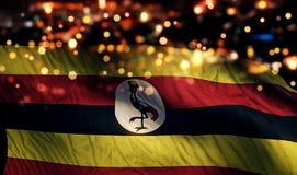 För Bokeh för natt för Uganda nationsflaggaljus bakgrund abstrakt begrepp Arkivfoton