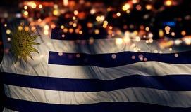 För Bokeh för natt för Uruguay nationsflaggaljus bakgrund abstrakt begrepp Fotografering för Bildbyråer