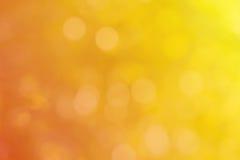 För bokehabstrakt begrepp för orange guling bakgrund för sommar Royaltyfri Bild