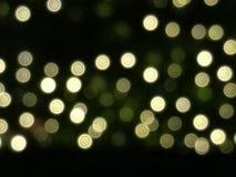 För bokehbakgrund för abstrakt guld och för gult ljus isolat på svart bakgrund, ljus på natten, valentin, nytt år, påsk eller spe Arkivfoton
