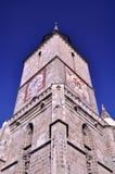 för brasovkyrka för klocka svart romania torn Royaltyfri Fotografi
