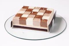 För chokladmousse för samtida tre kaka arkivbilder