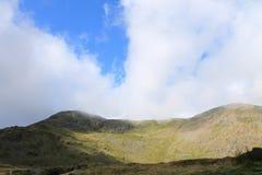 För Cumbria för sjöområdesnationalpark landskap berg Arkivfoto