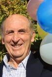 för deltagareavgång för födelsedag male pensionär royaltyfria bilder