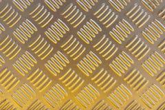 För diamantplatta för gul metall bakgrund för modell Royaltyfri Fotografi