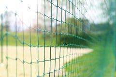 för djupfält för bakgrund grund volleyboll för oskarpt hav för framdel netto arkivbild