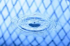 för droppfärgstänk för bakgrund blått vatten Fotografering för Bildbyråer