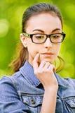 för exponeringsglas kvinna thoughtfully Arkivfoto