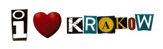 För förälskelseKrakow för ` I uttryck ` på vit bakgrund Arkivfoton