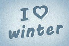 För förälskelsevinter för ` som I ` är skriftlig på snön Arkivfoto