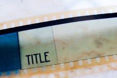 för filmram för mm 35 slut för etikett för titel upp Royaltyfri Fotografi