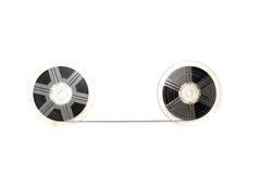 För filmrullar för tappning 8mm bakgrund för vit Arkivfoto