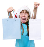 För flickahåll för lycklig jul påsar för shopping stora arkivfoton