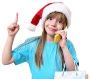 För flickahåll för lycklig jul påsar för shopping stora royaltyfria bilder