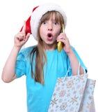 För flickahåll för lycklig jul påsar för shopping stora arkivfoto