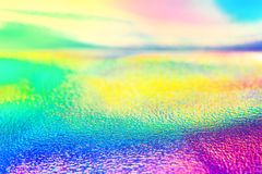 För folieneon för regnbåge verklig holographic tapet för textur Arkivbilder