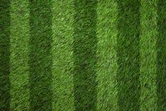 För fotbollfält för grönt gräs bakgrund Royaltyfria Bilder